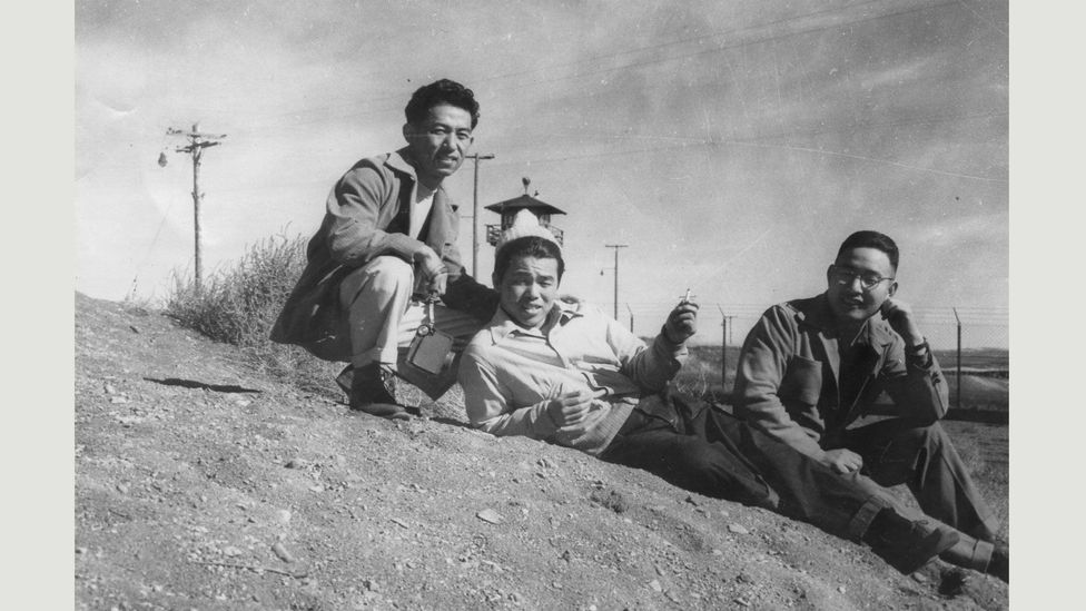 Three gay men by guard tower, Tule Lake concentration (relocation) camp, California, early 1940s (Courtesy of the Gay, Lesbian, Bisexual, Transgender Historical Society)