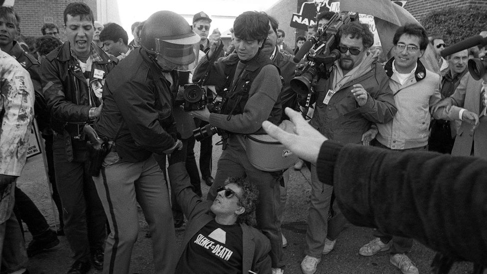 A man wearing a 'Silence Equals Death' T-shirt at a protest by the Aids activist group ACT UP (Aids Coalition to Unleash Power) at the US Food and Drug Administration in 1988