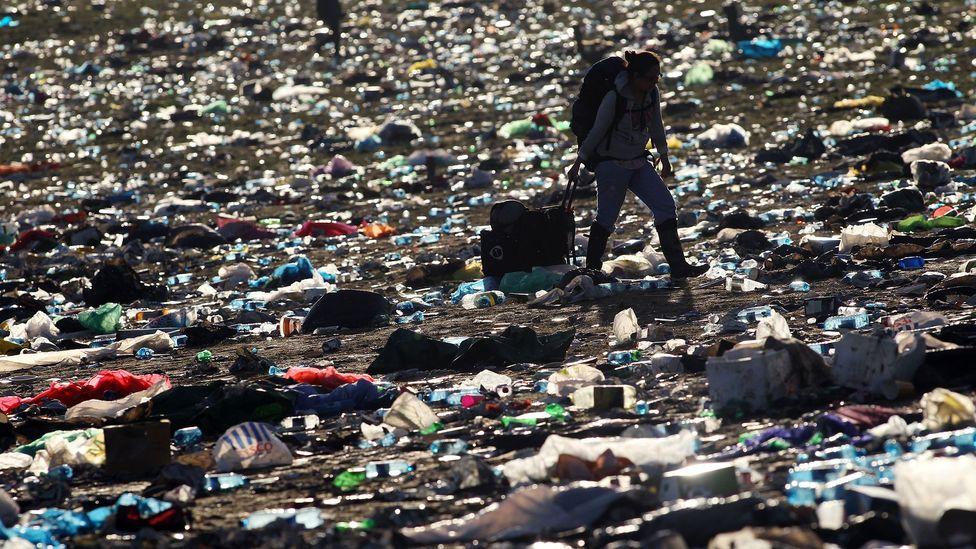Glastonbury field strewn with rubbish (Credit: Getty Images)