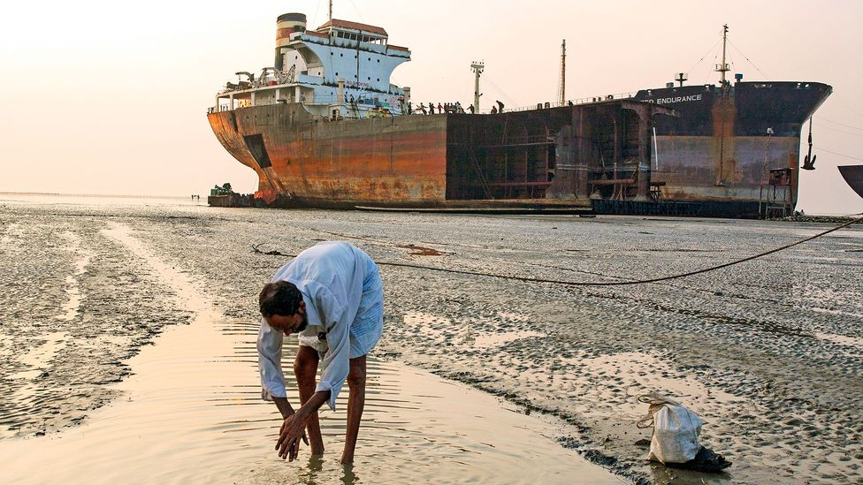 Oil tankers sent for scrapping are often run aground on beaches in Bangladesh where they are dismantled by hand by poorly paid unskilled workers (Credit: Getty Images)
