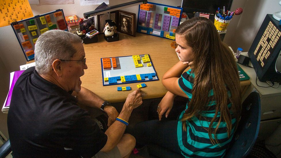 A certified dyslexia testing specialist in a home office uses colored tile manipulation for a multisensory approach to spelling (Credit: Alamy Stock Photo)