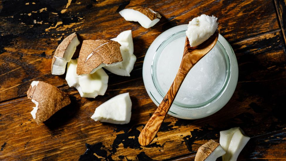 Coconut oil has more saturated fat than butter – and a single tablespoon has more than half of the recommended daily limit for women (Credit: Getty Images)