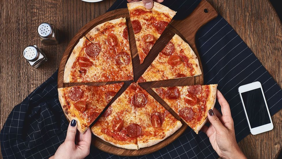 Two slices of pizza have about 10g of saturated fat, half of the suggested daily limit for a women and a third the daily amount for men (Credit: Getty Images)