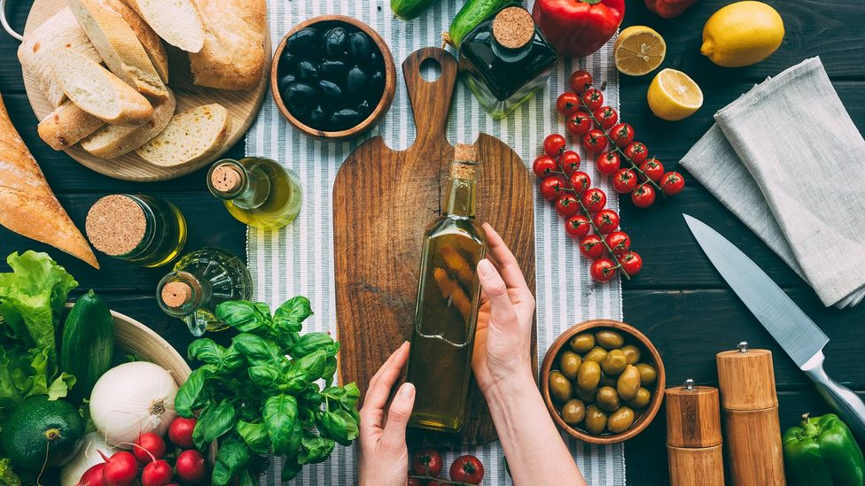 Replacing saturated fats with a monounsaturated fat, like olive oil, reduced deaths by 11% in one study (Credit: Getty Images)