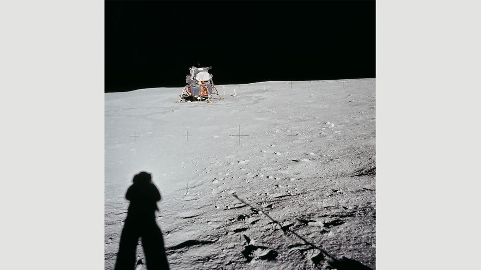 20 July, 1969: Armstrong photographs his shadow and the distant Lunar Module from the East Crater