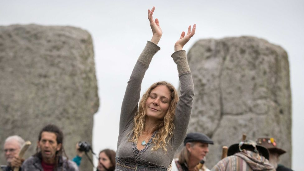 A woman dances as druids, pagans and revellers gather at Stonehenge (Credit: Getty Images)