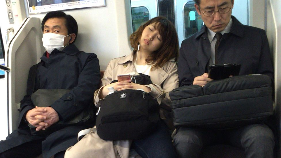 Known as 'inemuri', drifting off in public has become synonymous with exhausted workers in Japan (Credit: Getty Images)