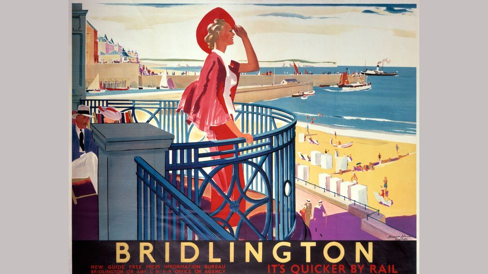 An elegant holidaymaker features in a 1930s poster promoting rail travel to the UK resort of Bridlington (Credit: Getty Images)