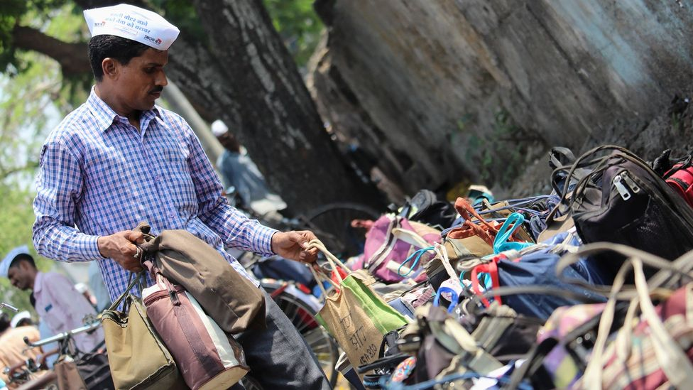 Dabbawala, a 125-year-old delivery service in India, can now be used with an app. With satellite internet, more Indians could access such apps (Credit: Getty Images)
