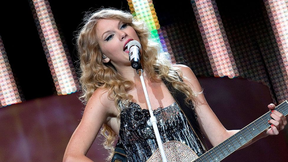Swift began her career as a guitar-toting country music star, before transforming her sound (Credit: Alamy)