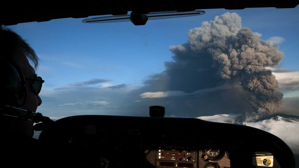 A light aircraft flies close to Eyjafjallajökull during the 2010 eruption which caused the highest level of air travel disruption since World War Two (Credit: Getty Images)