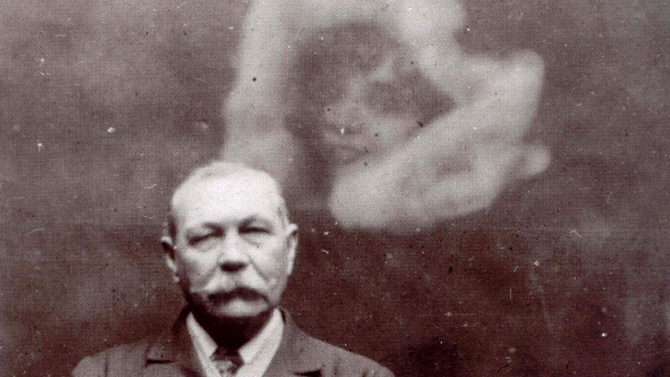 "A photo of Sir Arthur Conan Doyle with a ""spirit"", taken by the medium Ada Deane (Credit: Alamy)"