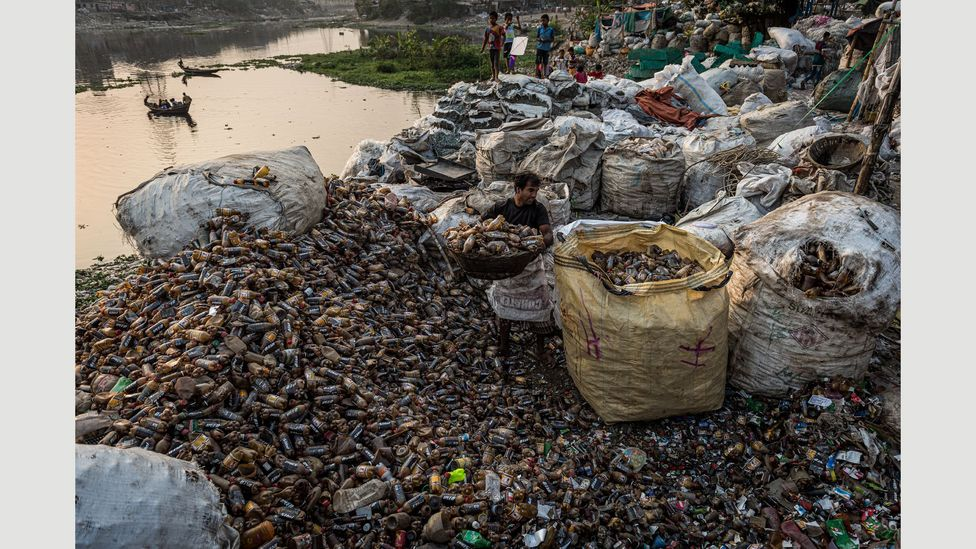 Migrants from rural Bangladesh often have to take low-paid work, like sorting through plastic waste, when they reach the cities (Credit: Ignacio Marin/ Institute)