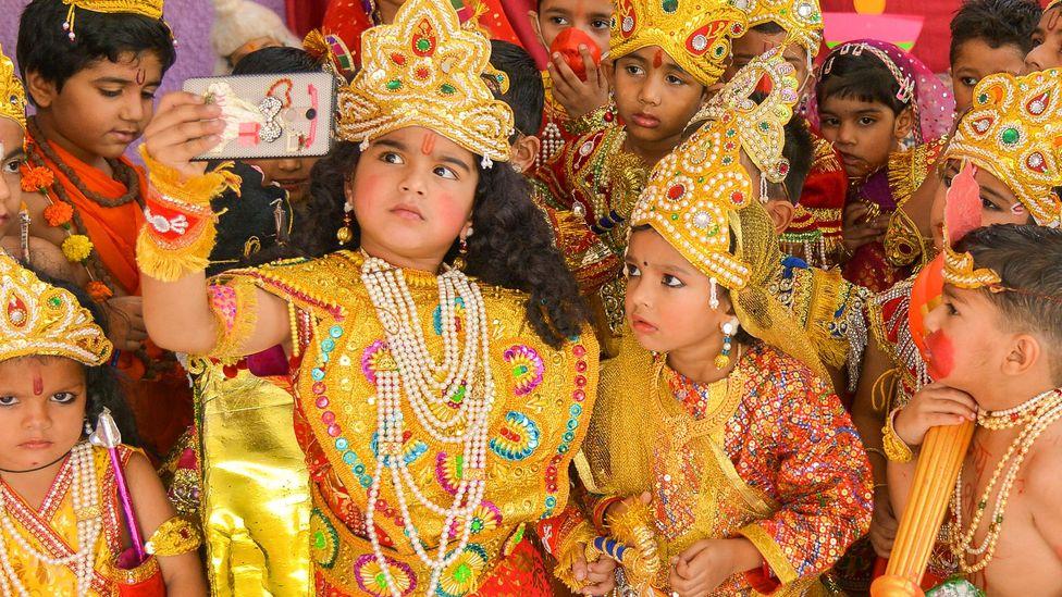 Indian children dressed as Hindu deities Rama and Sita celebrate Diwali (Credit: Getty)