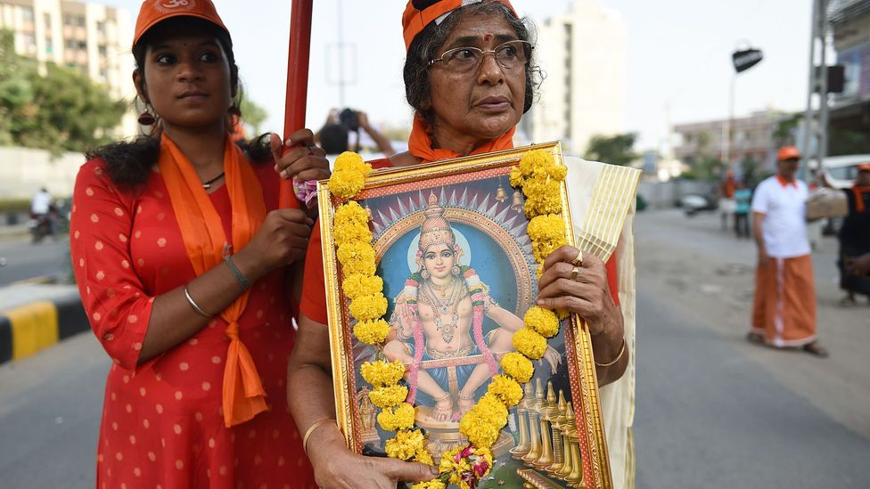 Religious devotees protested against India's decision to revoke a ban on women aged between 10 and 50 entering a Hindu temple in Kerala (Credit: Getty)