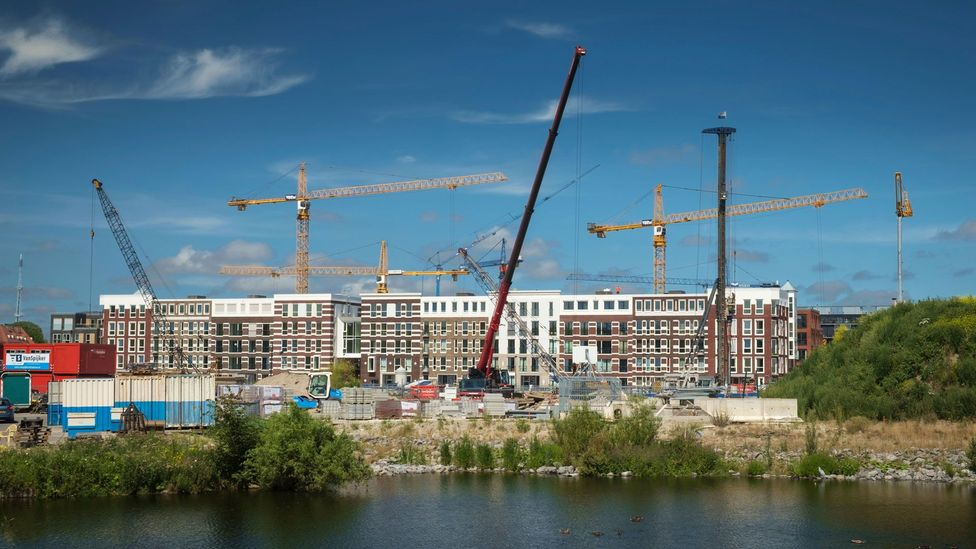 In high-growth cities including Amsterdam, some developers are building less-family-friendly towers to accommodate demand, or subdividing high-occupancy units (Credit: Alamy)