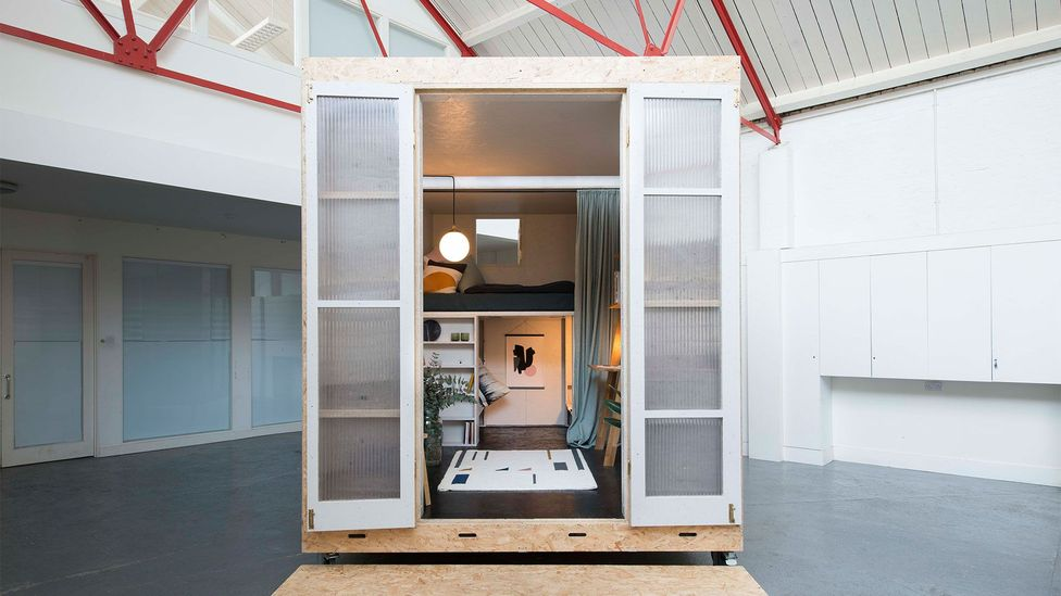 Richards's 11.15-sq m box on wheels was built as a parasitic home within an existing warehouse space. It fits a double bed, a desk and a chair (Credit: Studio Bark)