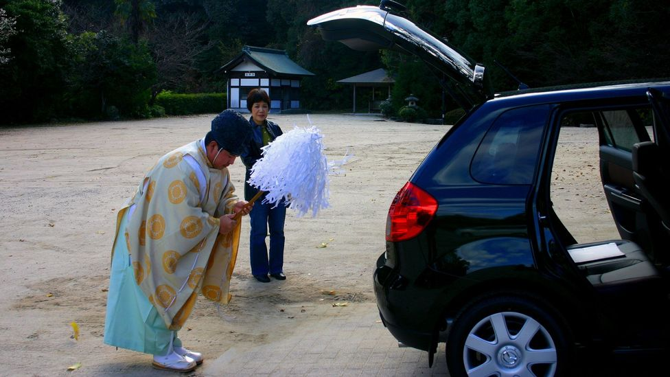 Many Japanese take their new car to a Shinto shrine to be purified by the priest (Credit: Angeles Marin Cabello)