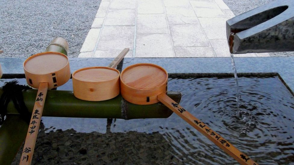 Before entering a Shinto shrine, worshippers rinse their hands and mouth in a stone water basin at the entrance (Credit: Angeles Marin Cabello)