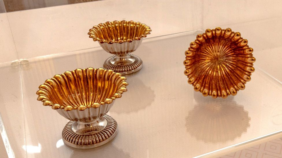 Salt plates from the 1800s feature in the exhibition's temple to salt (Credit: BBC)