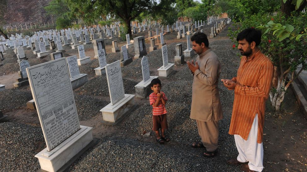 On Salam's gravestone in the Pakistani town of Rabwah he was described as the first Muslim Nobel Laureate, until authorities scrubbed out the word 'Muslim' (Credit: Getty Images)
