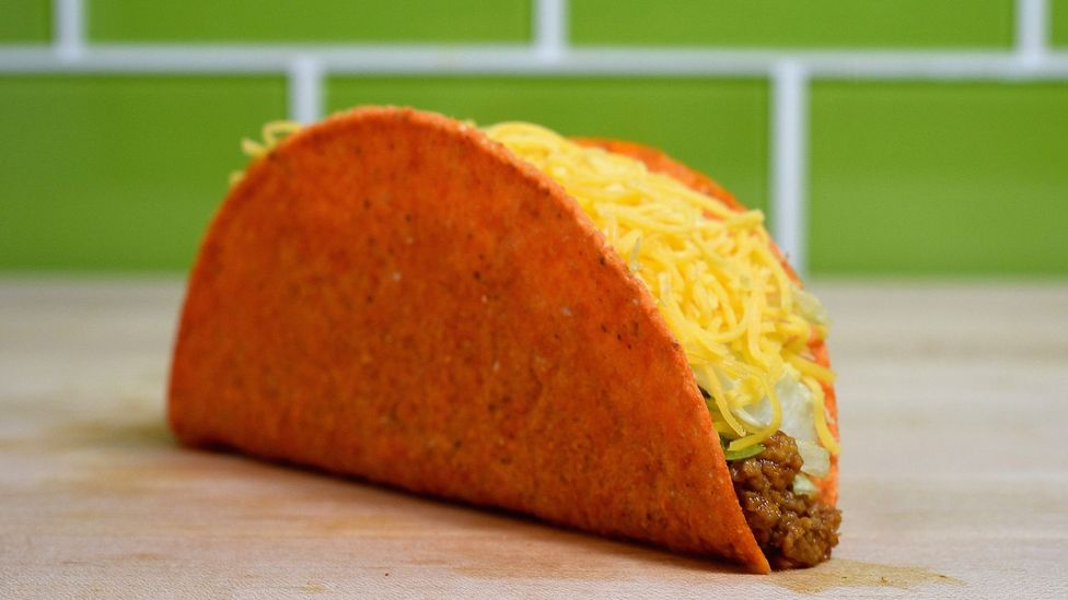 The fast food-snack food hybrid that started it all in 2012, Taco Bell's Doritos taco shell, just debuted in the UK earlier this month (Credit: Getty Images)
