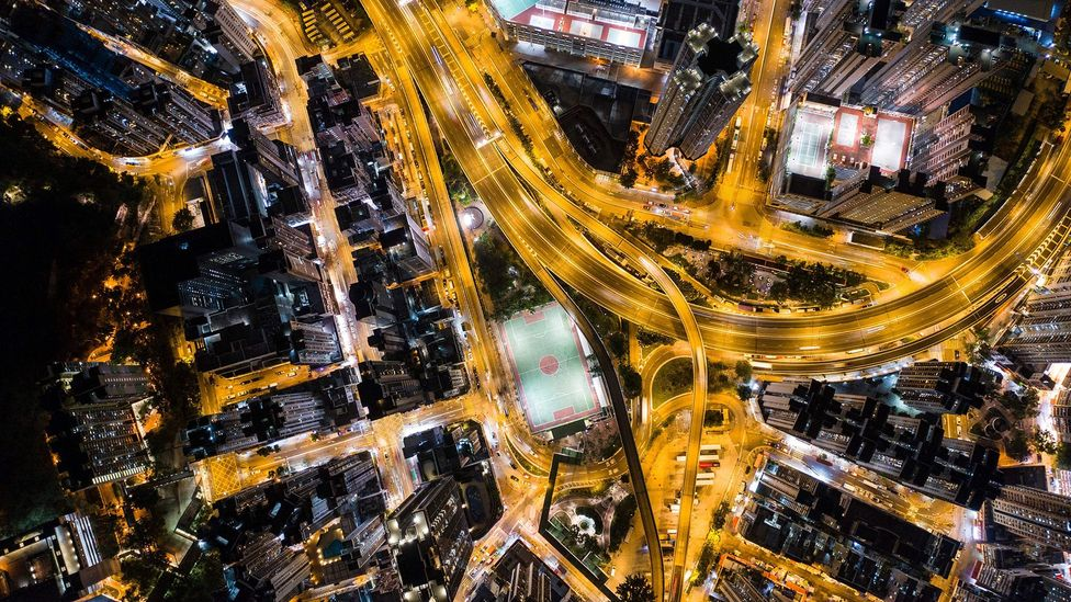 An aerial image of busy city streets at night (Credit: Getty Images)