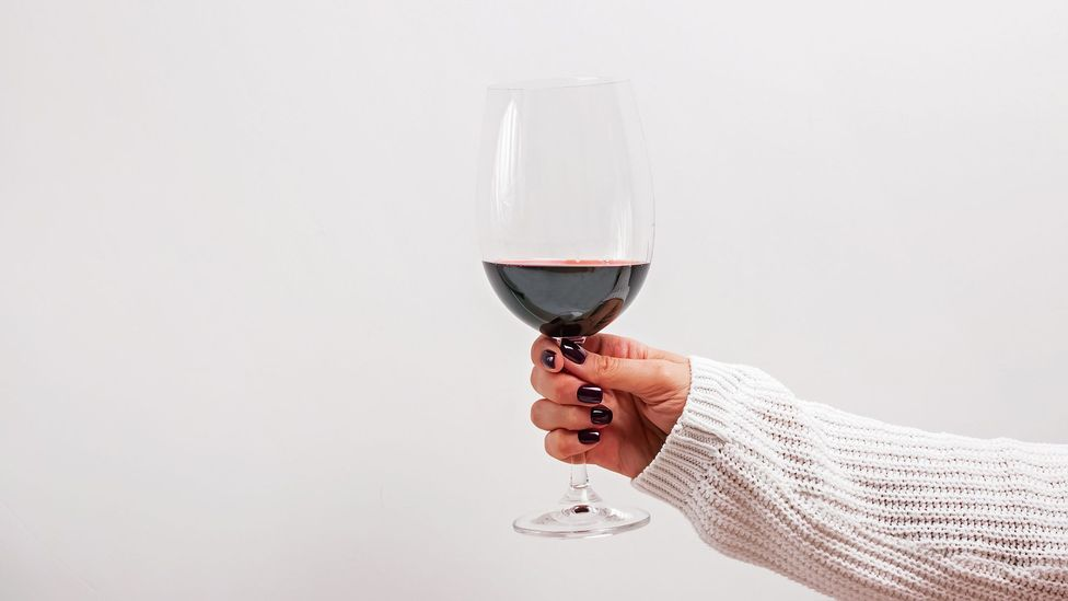 A glass of red wine a night is associated with lower BMI and better gut health, but red wine drinkers may simply be healthier to begin with (Credit: Getty Images)