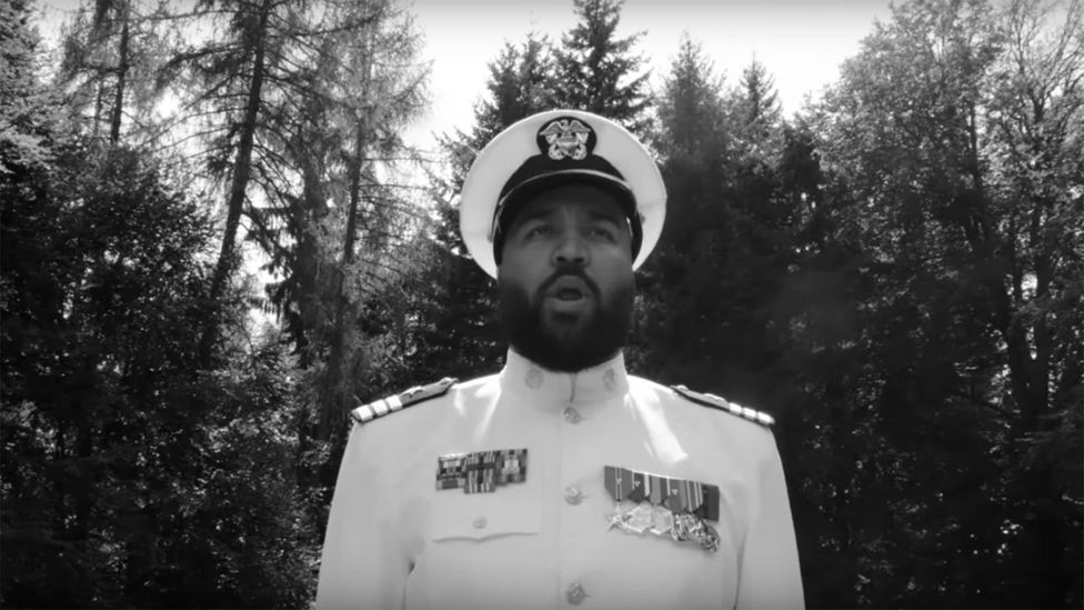 In the video for 216, OG Keemo wears a military uniform (Credit: Chimperator Productions)