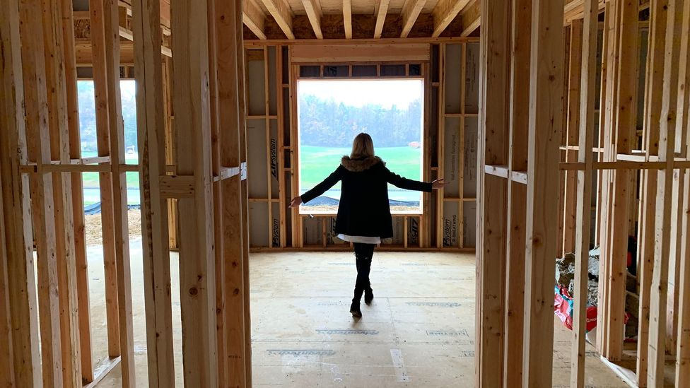 Rumson giving a tour of the construction so far in her new home (Credit: BBC)