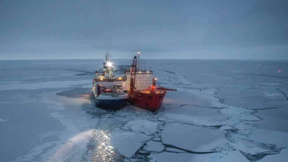 Polarstern and Akademik Fedorov, both more than 100m long, align starboard to starboard in the sea ice to transfer personnel, fuel and cargo (Credit: AWI/Esther Horvath)