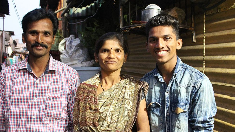 Omkar with his parents Raju and Kanta, who say they have seen significant changes in his behaviour since starting the programme (Credit: Chhavi Goyal)