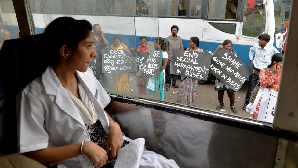 Protestors call for the end of the harassment of city bus passengers in Bangalore, where a study found two-thirds of female passengers face regular violence (Credit: Getty Images)