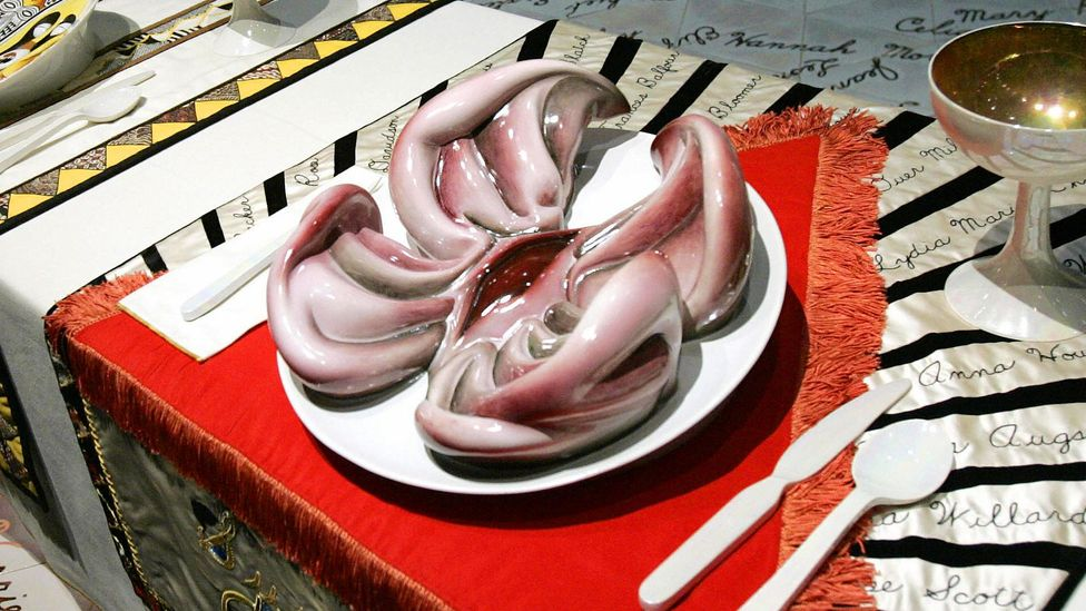 Judy Chicago's installation The Dinner Party (now in Brooklyn Museum) features vulva-shaped plates (Credit: Getty Images)