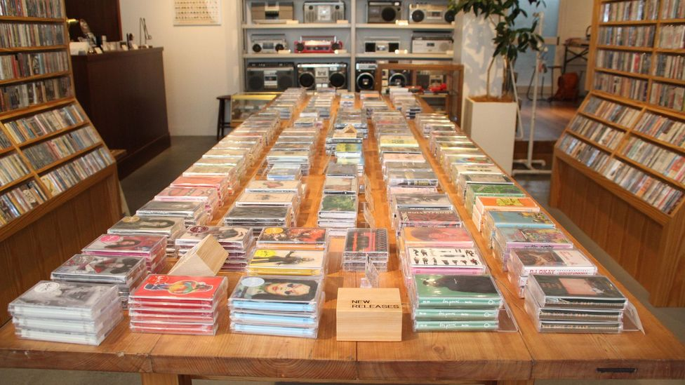 The interior of the cassette tape store waltz is designed with antique wood while the shelves were custom made to fit cassettes (credit: Yuko Komura)
