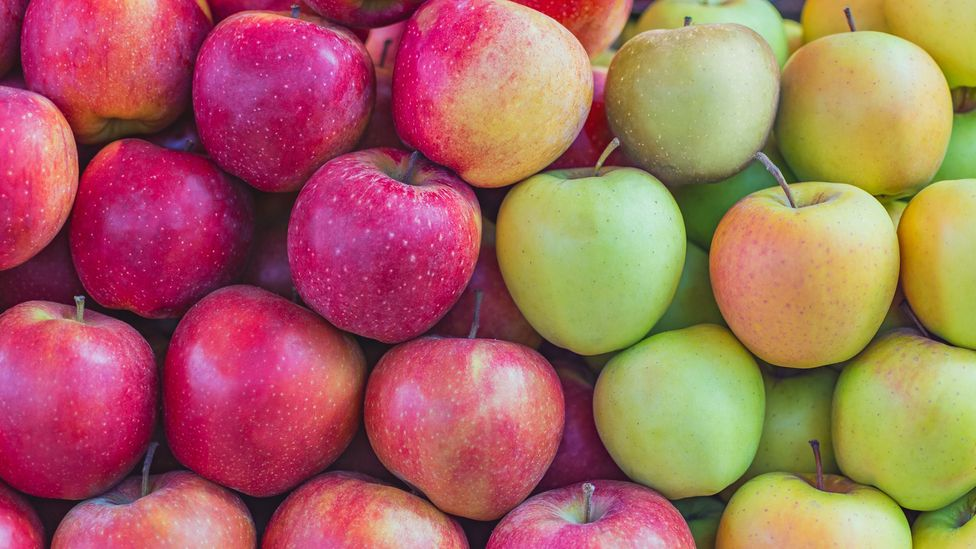 As temperatures rise, chemical changes within the apple make a red skin less likely (Credit: Getty Images)