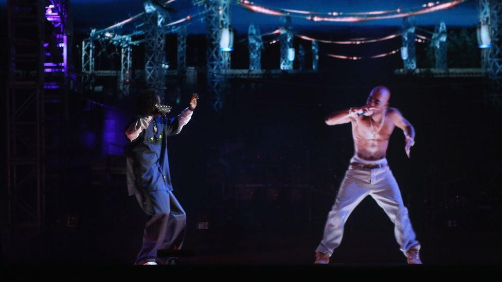 "A hologram of deceased rapper Tupac Shakur ""performed"" with living rapper Snoop Dogg in 2012 (Credit: Getty Images)"