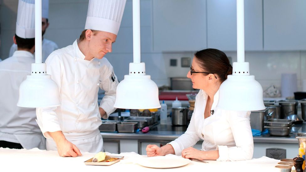 Anne-Sophie Pic consults with her team about the day's best food pairings (Credit: Andrea Savorani Neri)