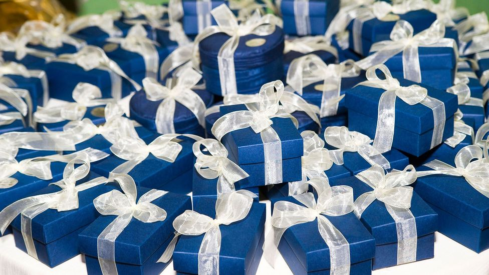 Gift-giving has many purposes and effects, but a common one is to signal an attitude of commitment to the recipient (Credit: Alamy)