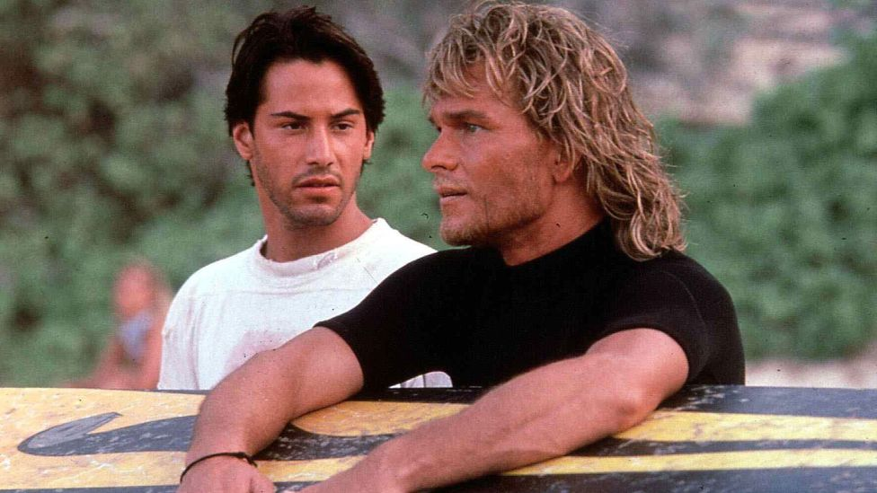 Following an undercover FBI agent investigating a group of bank robbers, Point Break has gained a cult following since its release in 1991