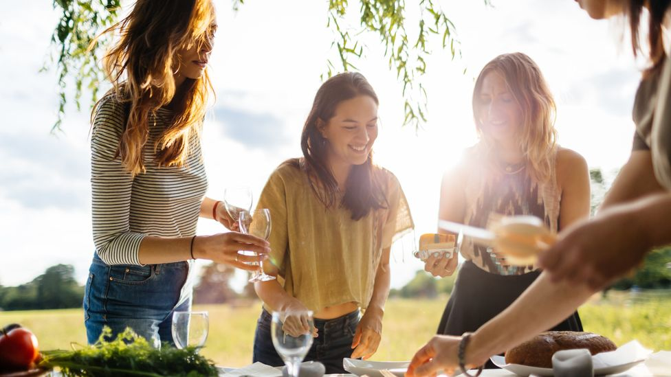 Studies have shown time and again that people eat more when sharing a meal with a group than when by themselves (Credit: Getty Images)
