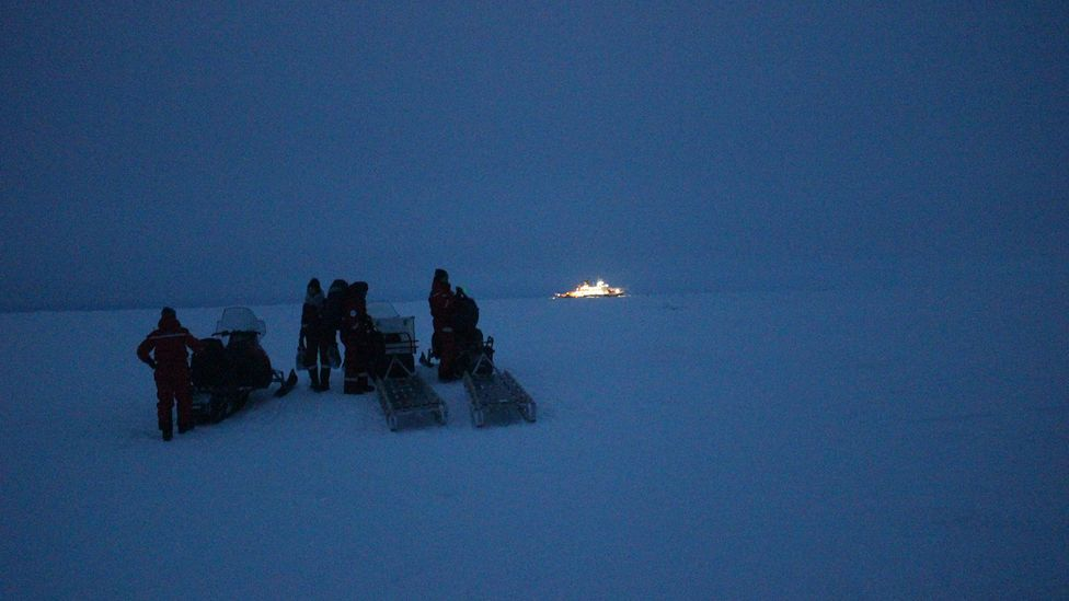 Scientists wait to leave the ice floe by helicopter, to travel back to the Akademik Fedorov (Credit: Martha Henriques)