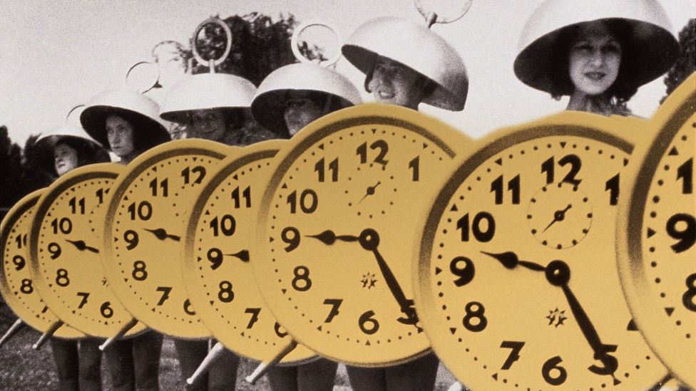 Line of women dressed as clocks (Credit: Javier Hirschfeld/Getty Images)