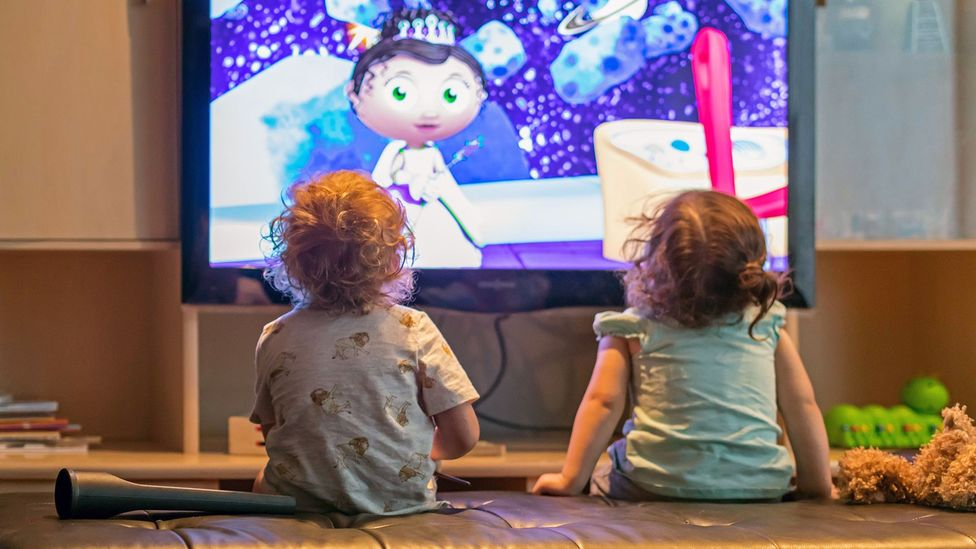 Young children's attention is attracted towards very different things compared to adults so television shows use this to help them follow what is going on (Credit: Alamy)