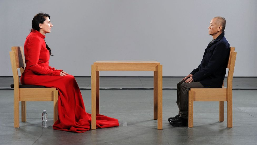 For her 2010 performance The Artist is Present, Marina Abramović met the gaze of strangers at MoMA – many of whom were moved to tears (Credit: Getty Images)