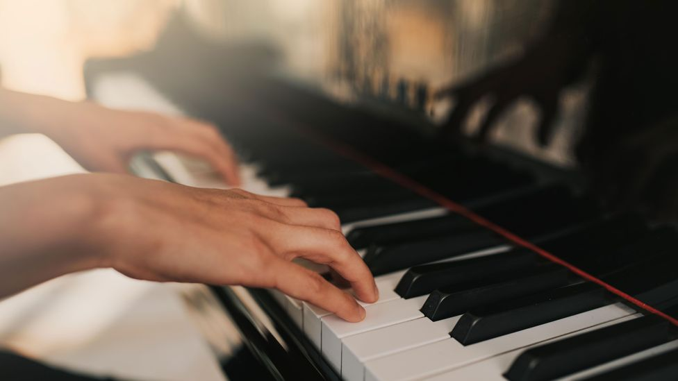Americans are more likely to say 'I play piano', whereas a Brit would probably say 'I play the piano' (Credit: Alamy)