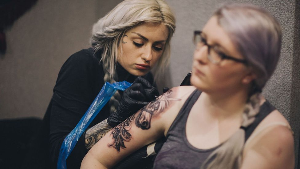 Although 38% of US millennials have a tattoo, only 30% say they keep it visible (Credit: Mykola Romanovksy)
