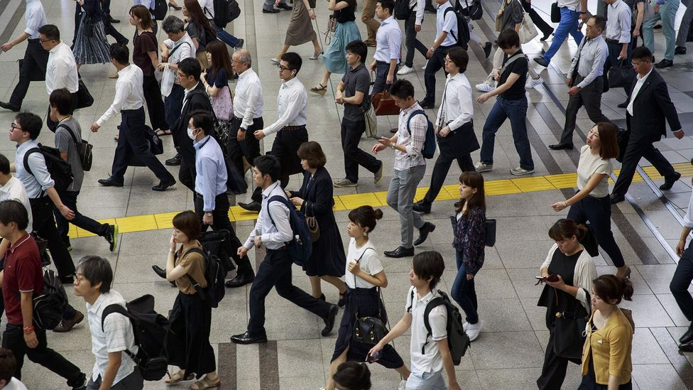 The fewer days taken off by Japanese employees in traditional companies, the better standing they have with their managers and coworkers (Credit: Getty Images)