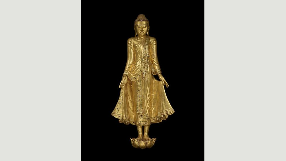 A gilded wooden statue, thought to have been commissioned by the last king of Burma, shows the Buddha in a healing pose (Credit: Trustees of the British Museum)