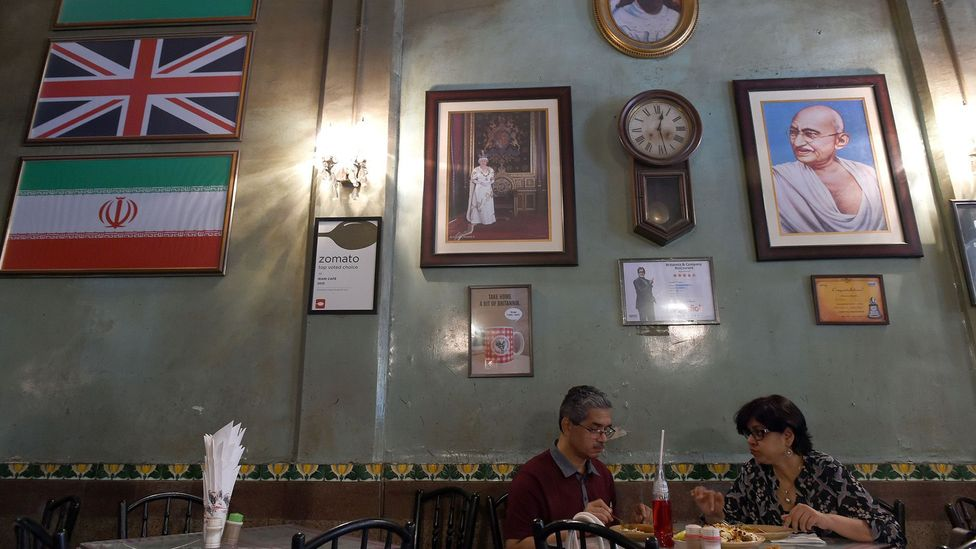 Britannia & Co Restaurant, with its Union Jack flag and image of Queen Elizabeth II, is one of Mumbai's most famous Irani cafes (Credit: Indranil Mukherjee/Getty Images)